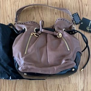 B Makowsky new leather and patent drawstring bag